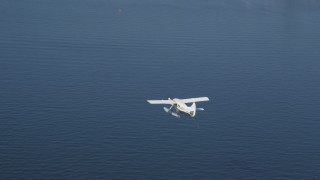 AX47_069 - 5K stock footage aerial video of tracking a seaplane taking off from Lake Union, Seattle, Washington