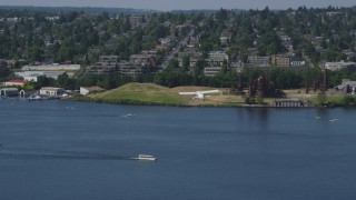 AX47_070 - 5K stock footage aerial video of tracking a seaplane flying over Lake Union, reveal Gas Works Park, Seattle, Washington