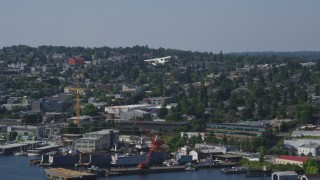 AX47_071 - 5K stock footage aerial video of tracking a seaplane and revealing Fremont Cut, Queen Anne, Washington