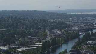 AX47_072 - 5K stock footage aerial video of tracking a seaplane flying over Queen Anne, Seattle, Washington