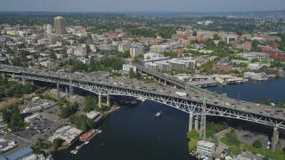 AX47_077 - 5K stock footage aerial video orbit heavy traffic on the Ship Canal Bridge; Seattle, Washington