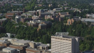 AX47_084 - 5K stock footage aerial video fly by University of Washington campus buildings, Seattle, Washington