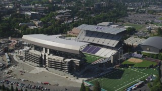 AX47_085 - 5K stock footage aerial video orbit Husky Stadium, University of Washington, Seattle