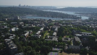 AX47_088 - 5K stock footage aerial video tilt from the University of Washington campus to reveal Portage Bay, Lake Union, and the skyline of Downtown Seattle, Washington