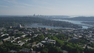 AX47_089 - 5K stock footage aerial video of Portage Bay, Lake Union, and the Downtown Seattle skyline seen from University of Washington campus