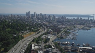 AX47_092 - 5K stock footage aerial video of following heavy traffic traveling Interstate 5 to approach Downtown Seattle skyline, Washington