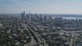 AX47_093 - 5K stock footage aerial video fly over heavy traffic on Interstate 5 to approach Downtown Seattle skyline in Washington
