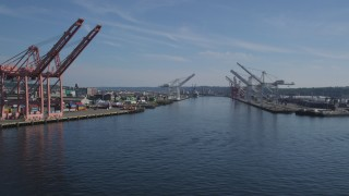 AX47_099 - 5K stock footage aerial video flyby cargo cranes lining the waterway at Harbor Island, Seattle, Washington