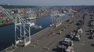AX47_100 - 5K stock footage aerial video of cargo cranes on either side of the Duwamish Waterway at Harbor Island, Seattle, Washington