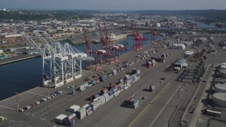 AX47_101 - 5K stock footage aerial video of cargo cranes and rows of shipping containers at Harbor Island, Seattle, Washington