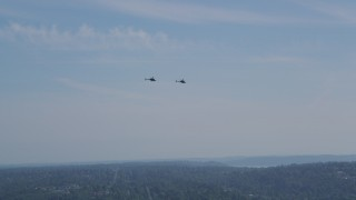 AX47_111 - 5K stock footage aerial video of tracking two Kiowa Warrior helicopters flying over West Seattle, Washington
