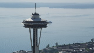 AX47_129 - 5K stock footage aerial video of circling the top of the Seattle Space Needle in Downtown Seattle, Washington