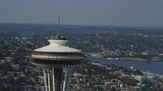 AX47_130 - Aerial stock footage of 5K aerial  video orbit around the top of the Space Needle, lake in the background, Downtown Seattle, Washington