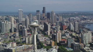 AX47_132 - 5K stock footage aerial video pass by the iconic Seattle Space Needle with skyscrapers in the background, Downtown Seattle, Washington