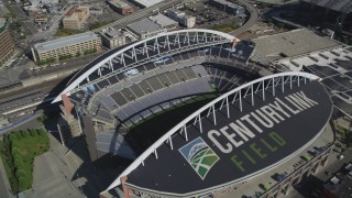 AX47_139 - 5K stock footage aerial video approach CenturyLink Field and tilt to a bird's eye view of the field, Downtown Seattle, Washington