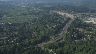 AX48_008 - 5K stock footage aerial video of I-405 with traffic congestion beside a residential neighborhood, Bellevue, Washington