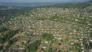 AX48_009 - 5K stock footage aerial video of flying over rows of suburban tract homes in Bellevue, Washington