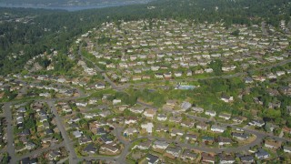 AX48_010 - 5K stock footage aerial video of flying over tract homes in a suburban neighborhood, Bellevue. Washington