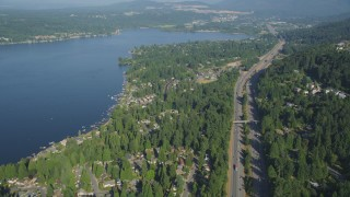 AX48_015 - 5K stock footage aerial video of lakeside homes on the shore of Lake Sammamish and light traffic on I-90, Issaquah, Washington
