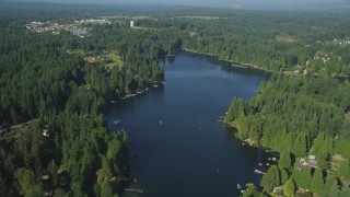 AX48_020 - 5K stock footage aerial video fly over a waterfront residential neighborhood on the shore of Pine Lake, Sammamish, Washington