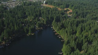 AX48_021 - 5K stock footage aerial video fly over Pine Lake and tilt to lakefront homes with docks, Sammamish, Washington