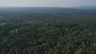 AX48_025 - 5K stock footage aerial video flyby a lush deciduous forest in Sammamish, Washington