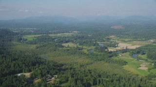 AX48_027 - 5K stock footage aerial video approach the Snoqualmie River winding around farmland in Carnation, Washington
