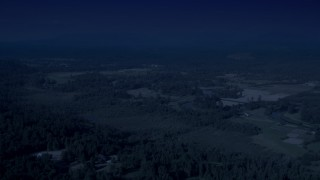 AX48_027_DFN - Aerial stock footage of 4K day for night color corrected aerial footage of farmland in Carnation, Washington