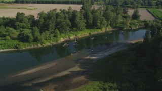 AX48_036 - 5K stock footage aerial video fly over the Snoqualmie River and a farm field in Carnation, Washington