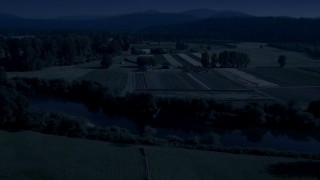 AX48_037_DFN - Aerial stock footage of 4K day for night color corrected aerial footage of the Snoqualmie River and farm fields in Carnation, Washington
