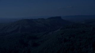 AX48_049_DFN - Aerial stock footage of 4K day for night color corrected aerial footage of green hills and evergreen forest in King County, Washington