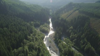 AX48_068 - 5K stock footage aerial video of following a river through the forest, King County, Washington