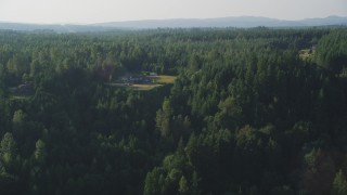 AX49_013 - 5K stock footage aerial video of flying by large, upscale homes surrounded by forest, Carnation, Washington