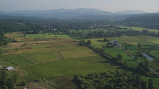 AX49_016 - 5K stock footage aerial video of rural farms and fields in Carnation, Washington