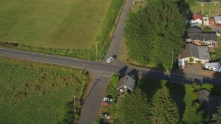 AX49_018 - 5K stock footage aerial video of tracking a white van on a country road through farmland, Carnation, Washington