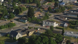AX49_019 - 5K stock footage aerial video of tracking a silver SUV on a road through a rural neighborhood, Carnation, Washington