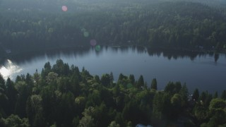 AX49_022 - 5K stock footage aerial video of tree-lined Ames Lake and lakefront homes in King County, Washington
