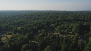 AX49_025 - 5K stock footage aerial video of evergreen forests and rural neighborhoods, Sammamish, Washington