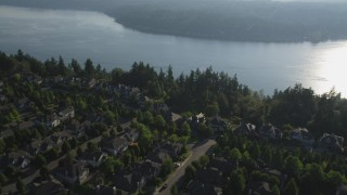 AX49_030 - 5K stock footage aerial video fly over upscale homes, and tilt from lakeside homes for a wide view of Lake Sammamish, Washington