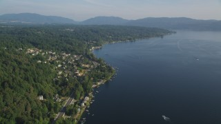 AX49_031 - 5K stock footage aerial video of homes on the tree-lined shore of Lake Sammamish, Washington