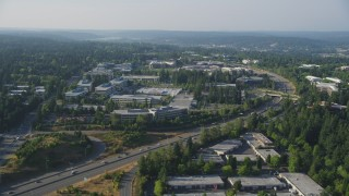 AX49_037 - 5K stock footage aerial video of Microsoft Headquarters office buildings and light traffic on State Route 520 in Redmond, Washington