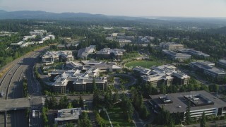 AX49_041 - 5K stock footage aerial video of reverse view of Microsoft Headquarters and light traffic on State Route 520, Redmond, Washington