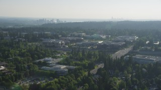 AX49_042 - 5K stock footage aerial video of reverse view of Microsoft Headquarters office complex in Redmond, Washington