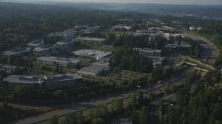 AX49_045 - 5K stock footage aerial video of passing by Microsoft Headquarters office complex beside freeway with light traffic in Redmond, Washington