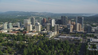 AX49_050 - 5K stock footage aerial video of flying by skyscrapers and high-rises, Downtown Bellevue, Washington