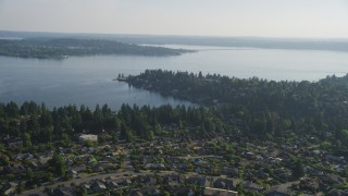 AX49_051 - 5K stock footage aerial video fly over suburban neighborhoods toward waterfront homes on Lake Washington, Bellevue, Washington