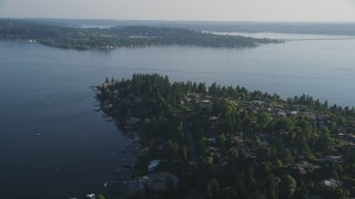 AX49_052 - 5K stock footage aerial video of flying by lakeside homes with docks on the shore of Lake Washington, Bellevue, Washington