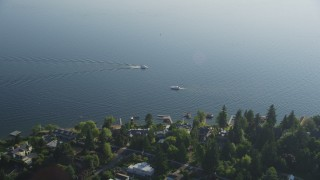 AX49_053 - 5K stock footage aerial video fly over lakeside houses to approach fishing boats on Lake Washington, Bellevue, Washington
