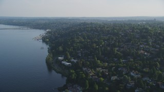 AX49_055 - 5K stock footage aerial video of lakefront homes and suburban neighborhoods by Lake Washington, Madrona, Washington