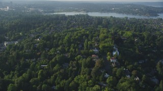 AX49_056 - 5K stock footage aerial video fly by residential neighborhoods and lush green trees, Madrona, Washington